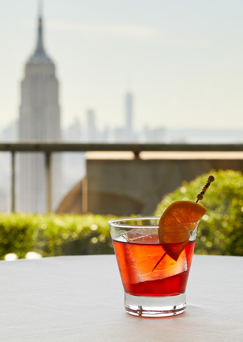 Rooftop cocktail bar with a NYC skyline view.